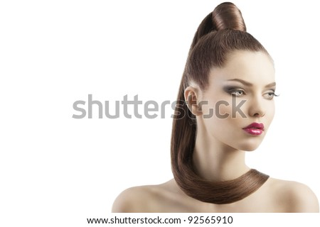 very attractive young brunette with long hair and tail and creative hair style looking luxory and proud, she is turned of three quarters and looks down at left and has a lock of hair around her neck - stock photo