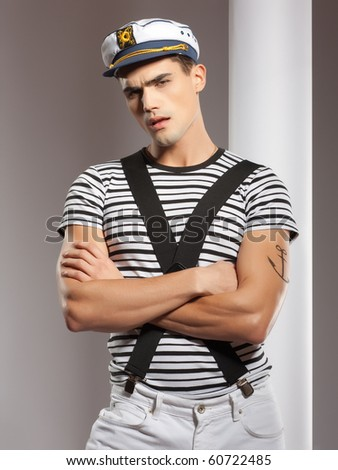very attractive young man model dressed like a sailor - studio shoot - stock photo