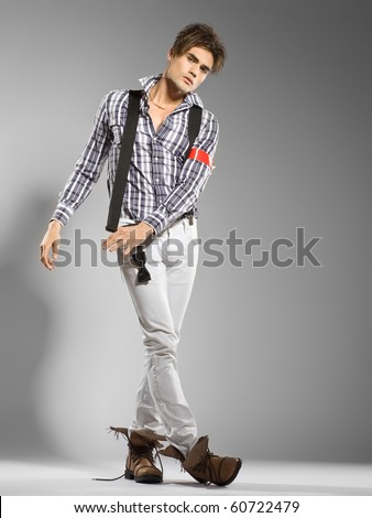 very attractive young man model looking away - clean studio shoot - copy space - stock photo