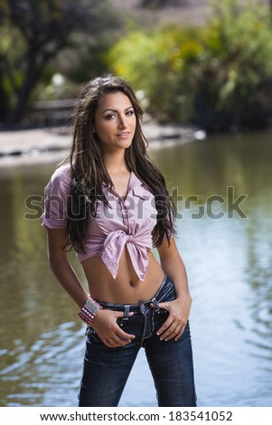 Very attractive young women posing in jeans and t-shirt - stock photo