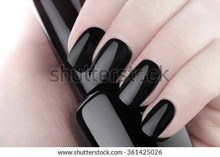 Very beautiful black nails close up. - stock photo