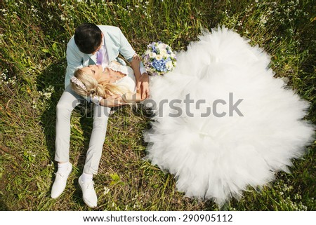 Very beautiful bride and groom in a field where many colors and beautiful nature