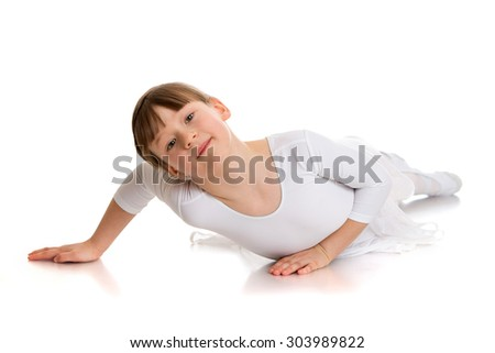 Very beautiful girl in short hair lying on the floor. The girl is wearing a white suit dancing-Isolated on white background