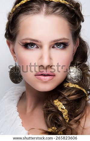 Very beautiful girl in the Greek style with bright makeup. Greek Goddess - stock photo