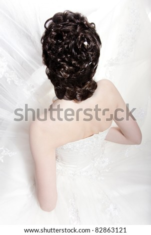 Very beautiful girl the bride, with hairdress - stock photo