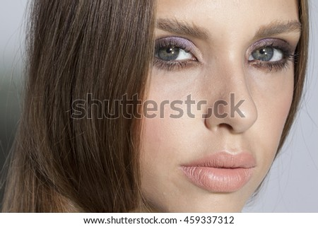 very beautiful girl with make up and chubby lips and long hair