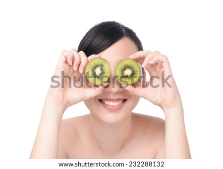Very beautiful girl with naked shoulders, showing us two halves of Kiwi as her eyes. Isolated on the white background - stock photo