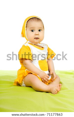 very  beautiful  little kid , sit on green  textile  on white  background, isolated - stock photo