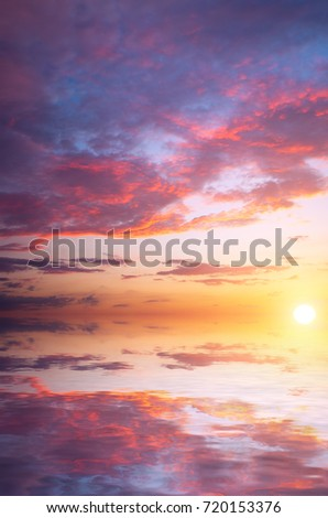 Very beautiful sunrise over the sea in the autumn sky with cumulus clouds. Natural sunset composition