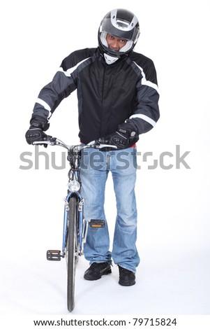 very  cautious biker - stock photo