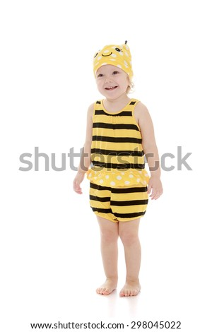 Very charming little Caucasian girl in a suit with black and yellow stripes,a girl stands barefoot on the floor-Isolated on white