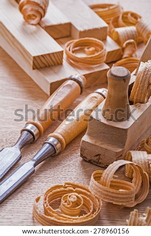 very close up view joinery tools old fashioned woodworkers plane chisels planks shawings  - stock photo