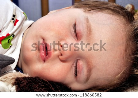 Very closeup portrait of the sleeping baby - stock photo