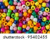 Very colorful pile of beads. - stock photo