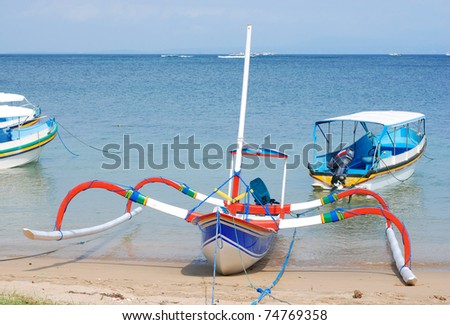Very colorful traditional fishing boat in bali. - stock photo