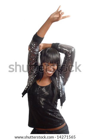 Very cool young woman with headphones in a clubbing outfit - stock photo