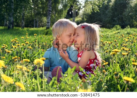 Very cute beautiful little sister hugging her big brother.S sweet. - stock photo