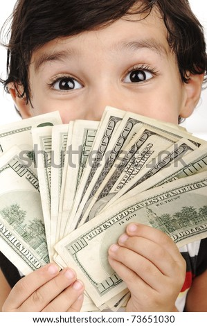Very cute boy with money, dollars in hands - stock photo
