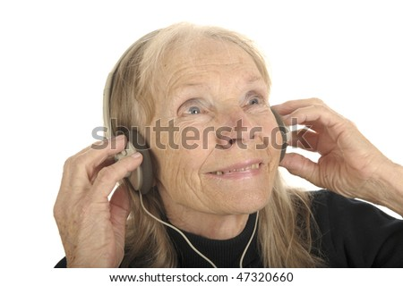 Very Cute Image Of a Senior Woman Listening To Music - stock photo