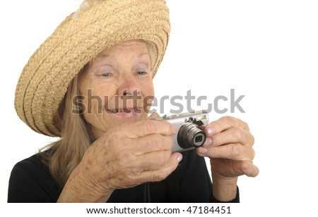 very Cute Image of a Senior woman with A Camera - stock photo