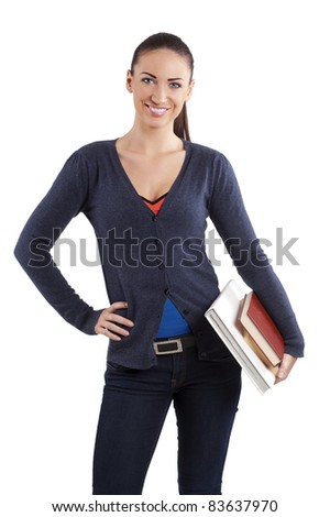 very cute smiling young college student in casual dress with book looking in camera