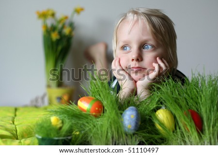 Very cute 5 years old boy. Narcissus on background - stock photo