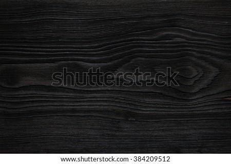 Very dark wood texture close up - stock photo