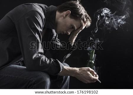 Very depressed man - stock photo