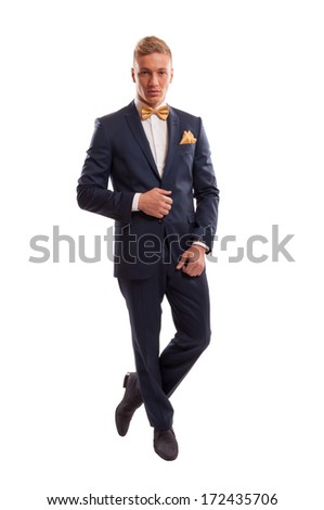 Very elegant businessman wearing an elegant suit with a yellow bowtie and a handkerchief