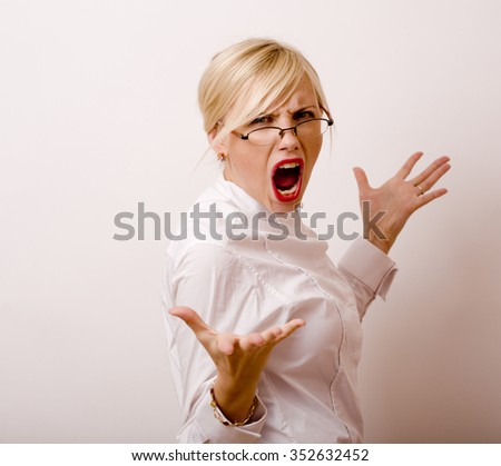 very emotional businesswoman in glasses, blond hair on white background. teacher hands up posing isolated. pointing  gesturing - stock photo