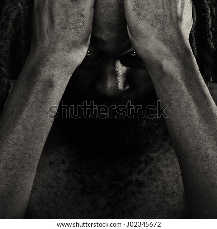 Very Emotional Image Of a Afro American Man with Shame - stock photo