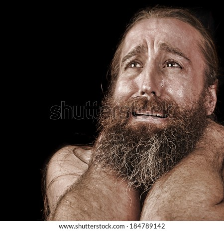 Very Emotional Image of a bearded Homeless man Crying - stock photo