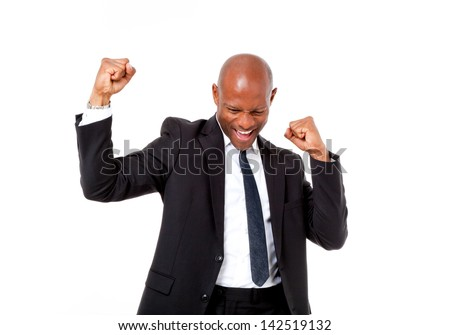 Very excited African business man with his arms in the air shot in an isolated background - stock photo