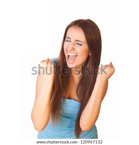very excited woman clenched fists and closed eyes - stock photo