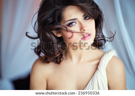 Very gentle sensual girls brunettes with brown eyes in a beige dress , close up - stock photo