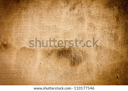 Very grungy plaster brown wall background - stock photo