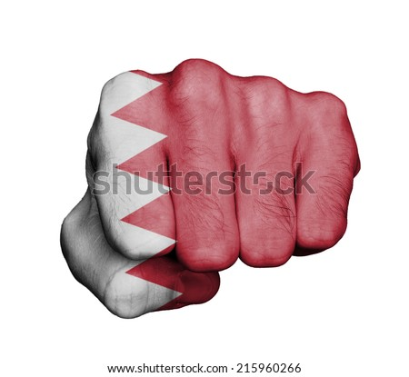 Very hairy knuckles from the fist of a man punching, Bahrain - stock photo