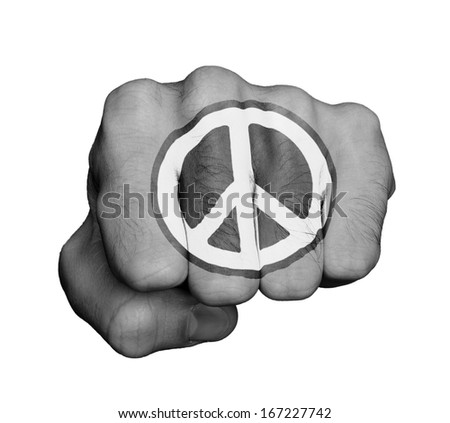 Very hairy knuckles from the fist of a man punching, peace symbol - stock photo