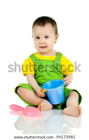 very happy, beautiful,  joy, little kid , play with toy on white background - stock photo