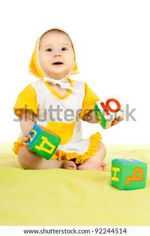 very happy, beautiful,  joy, little kid , sit and play with brick  on white background - stock photo