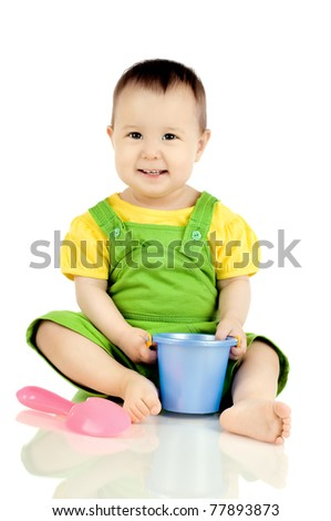 very happy, beautiful,  joy, little kid , sit and play with toys  on white background - stock photo