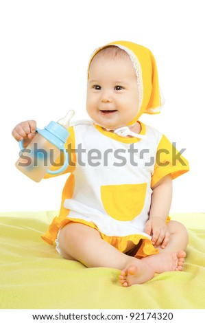 very happy, beautiful,  joy, little kid , sit with feeding bottle,   on white background, isolated - stock photo