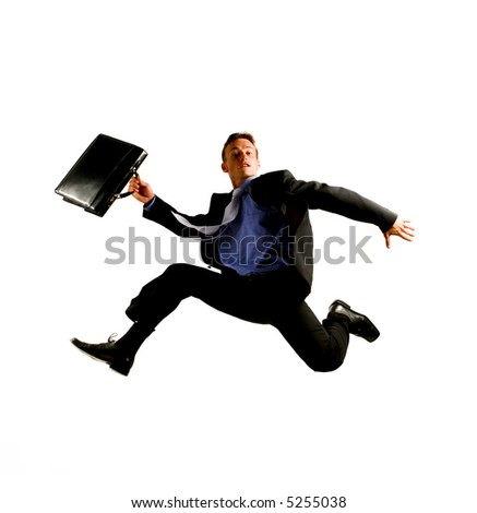 very happy energetic businessman jumping into the air