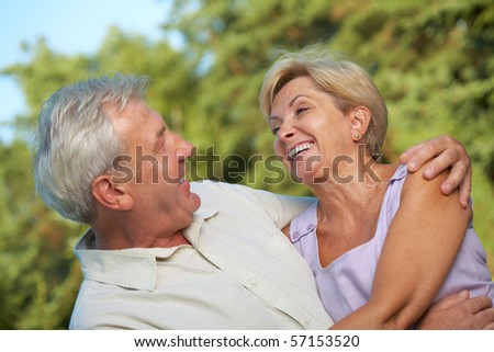 Very happy mature couple. Focus on woman. - stock photo
