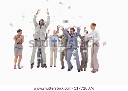Very happy people with money falling from the sky against white background