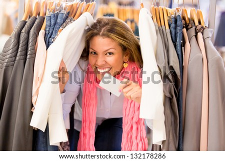 Very happy shopping woman holding a credit card at the store - stock photo