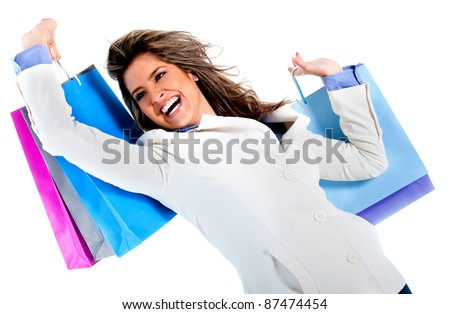 Very happy shopping woman holding bags - isolated over a white background