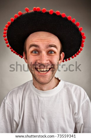Very happy stupid laughing man in sombrero hat - stock photo