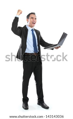 very happy successful businessman with laptop isolated on white background - stock photo
