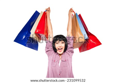 very happy woman raising arms with shopping bags - stock photo